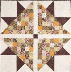 """Designer Anita Peluso created this quilt to showcase 5"""" charm squares. Simply chain piece the squares, add a few large triangles and squares, and you'll have a quilt in just a few days. Video piecing tutorial available! Find this quilt in Quilting Quickly Fall '14."""