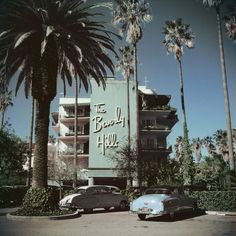 Slim Aarons - Beverly Hills Hotel. 1957—Cars parked outside the Beverly Hills Hotel on Sunset Boulevard in California.