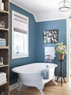 A white clawfoot tub in a blue bathroom. The walls of this blue bathroom (which happens to be from our 2010 eco-friendly House of the Year!) are Benjamin Moore Natura in Fiji. Bad Inspiration, Bathroom Inspiration, Bathroom Ideas, Bathroom Photos, Budget Bathroom, Painting Bathroom Walls, Room Paint, Blue White Bathrooms, Country Blue Bathrooms