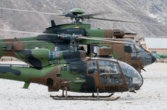 French helicopters Gazelle and Super Puma, wait to takeoff at FOB Nejrab , Kapisa Province, Afghanistan