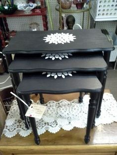 "$21.95 - This set of three nesting tables have been painted black with white floral stencil on each one. The largest table measures 18 1/2"" across the front, 12"" deep and stands 17"" tall. Set can be seen in Booth A18 at Main Street Antique Mall, 7260 E Main St (E of Power Rd) Mesa, AZ 85207 - 480-924-1122 - Open 7 days a week 10a.m. to 5:30p.m. - Cash or Charge accepted."