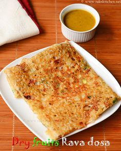 Rava dosa made with dry fruits and nuts like cashews, almonds, pista, dates, tutti frutti, raisins. With step by step pictures!