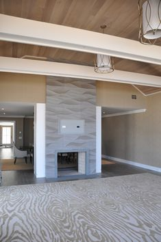 Artistic Tile | Designer Stacey Gendelman, Stacey Gendelman Designs | This beautiful fireplace is made up of Ambra, one of our many hand carved collections!