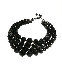 Hey, I found this really awesome Etsy listing at https://www.etsy.com/listing/385784380/black-bead-necklace-vintage-multi-strand