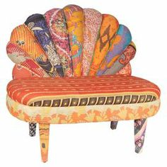 """Crafted from mango wood and showcasing multi-pattern cotton upholstery, this eye-catching accent chair brings a touch of artful appeal to your living room or den.  Product: ChairConstruction Material: Mango wood and vintage kantha cotton Color: MultiFeatures:  HandcraftedQuilted detailingOne-of-a-kind Dimensions: 36"""" H x 40"""" W x 22"""" DNote: Due to the vintage nature of this product, some wear and tear is to be expected. Products may show signs of brand marks, scrapes or other blemishes. ..."""