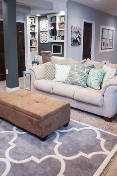 have the couch and the rug. need to paint and get an ottoman basically exactly like this one and get some fabric to make pillows and curtains. this is perfection.