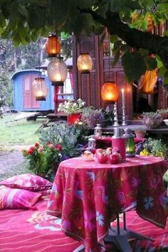 love the lanterns hanging off the branches, the colour and the flowers ... very gypsy, homely and pretty