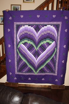 Mom's Purple Heart.I want to make and finish a beautiful quilt like this.