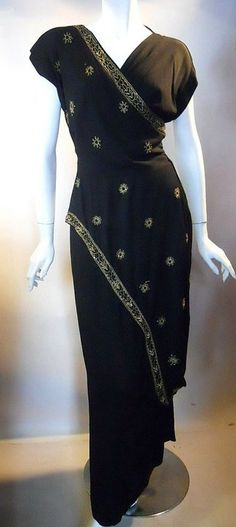 Black crepe rayon 40s evening gown with goddess inspired draping adorned with gold beads and soutache braid