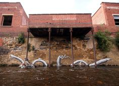 """Phlegm Briton, who is known for painting figures in black and white, with no mouth mystical characters, just made some new parts in Sheffield. Taking advantage of a river and its surroundings, new murals Phlegm mixed seamlessly with its context. The characters of this artist pezca left in this group of paintings titled """"Waterways"""". Chequen images and tell us what they seem."""