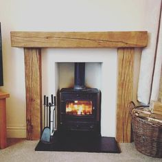 We can also offer full fire surrounds. This beautiful rustic fireplace surround is from old seasoned oak, hand worked and waxed to a stunning finish. Wooden Fire Surrounds, Oak Fire Surround, Wooden Fireplace Surround, Wood Stove Hearth, Wood Burner Fireplace, Concrete Fireplace, Fireplace Surrounds, Fireplace Mantels, Log Burner Living Room