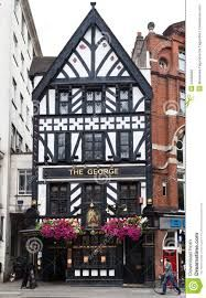 Photo about The facade of the half timber medieval building of The George Pub in downtown London, England. Image of building, flowers, downtown - 22498922 London Travel, Editorial Photography, Facade, England, Europe, Autumnal, Building, Image, Buildings