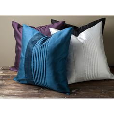 Prune purple and maroon -- decorative satin pillow has a hidden zipper and an appealing shape. Featuring a lovely pleated design, this pillow measures 22 inches square and is certain to be a favorite.