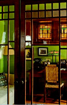The wall colour green is superb with rich dark wood trims.