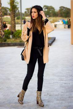 camel coat + black chiffon shirt + black skinny jeans + snakeskin leather heeled ankle boots + black shoulder bag