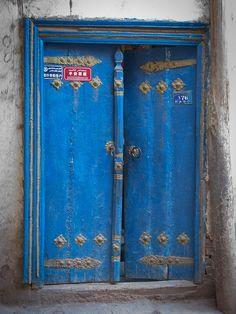 Painted blue door in Kashgar Old Town, China    Kashgar Old City, Xinjiang, China