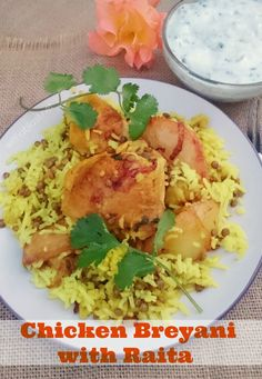 One of the MOST popular Chicken dishes - Chicken Breyani served with Raita on the side {as a sauce or dip} - spicy, scrumptious homemade meal - excellent recipe !
