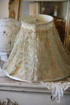 Repurpose an old shade with daughter's favorite skirt/dress...