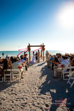 Beautiful beach ceremony at Lido Beach Resort in Sarasota, FL