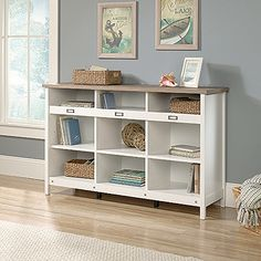 Enhance any room with this attractive and versatile storage credenza. The cube storage style offers multiple shelves for tucking away baskets and other household items. Features of this storage furniture include: Cubbyhole storage. Accommodates ID label tags. Three adjustable shelves. Soft White finish with Lintel Oak accent.