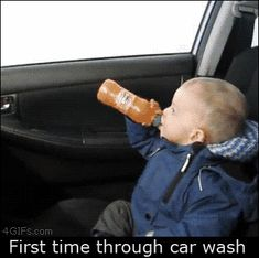 Baby's first time through a car wash GIF