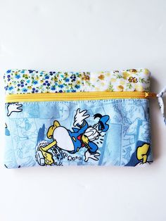 Disney Donald Duck zippered pouch/ coin purse/ small makeup bag by PopThree on Etsy https://www.etsy.com/listing/281628134/disney-donald-duck-zippered-pouch-coin