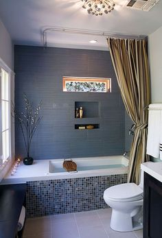 Love the tile below the tub and the built in cubbies for soap and shampoo