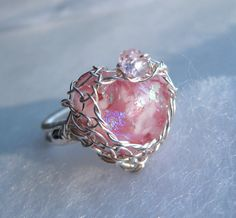 A netted glass heart wire wrapped ring.