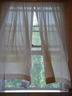 curtains blowing in a summer breeze
