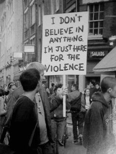 """I don't believe in anything, I'm just here for the violence."" now there's a man i could get behind. a healthy does of humor and willingness to get his ass kicked for no reason. Jm Barrie, Chaotic Neutral, Protest Signs, Protest Art, The Villain, Funny Signs, I Laughed, Haha, Believe"
