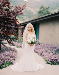 Gorgeous Poolside Wedding At A Private Residence In Orange County: This brides lace dress looks absolutely stunning paired with a white bouquet!