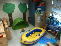 """My preschool Camping Center complete with """"campfire"""" with hot dogs and marshmallows to roast. There are magnetic fish in the """"pond"""" to catch, and plenty of dress up clothes will be added for imaginative play. Lots of fun!"""
