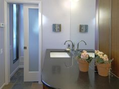 CLASSICALLY SIMPLE CONTEMPORARY BATH, Pocket door to close the WC