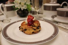 Tea-soaked raisin scone, Devon cream, and jam. At afternoon tea at The Langham, Chicago