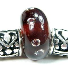 Rootbeer Large Hole Handmade Lampwork Charm Bead With Cubic Zirconias            Handmade lampwork bracelet charm bead - Dark amber rootbeer with 8 brilliant cz cubic zirconias large hole handmade...@ artfire