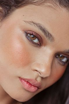 Create a bronzy glow with a rose colored blush