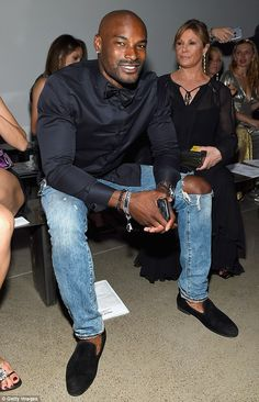 Dapper in dark blue: Tyson Beckford looked studly in a dark blue button-up shirt with ligh...