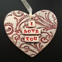 """too cute - made from white earthenware clay and decorated with the words """"I Love You"""" It has a red swirly background finished off with a crackle glaze for a shabby chic look"""