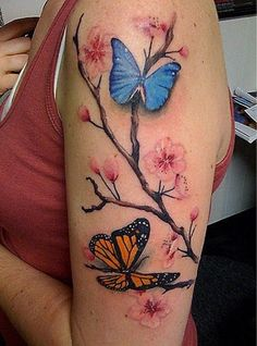 Cheery blossom and butterflies tattoo on arm - Tattoo Mania