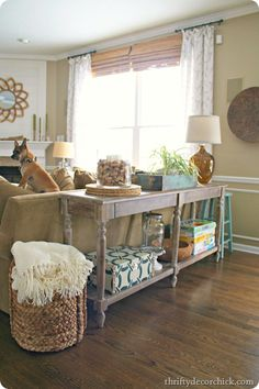 Two of these tables for the living room. I even love the basket next to it!