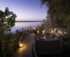 The ten tented and thatch rooms at DumaTau are built on raised decks under mangosteen trees and overlook an enormous lagoon. Each of the tents has an en suite bathroom and open air shower. The public areas comprise a dining area, bar, lounge and plunge pool. #safari #bar #lagoon