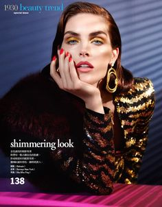 Shining in gold, Hilary Rhoda wears gold eyeshadow and lacquered manicure. Photo: Enrique Vega