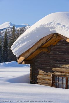 I wish I could wake up in a cabin with 3 foot load of snow on my roof :) Snow load on a log cabin roof in Wiseman, Alaska
