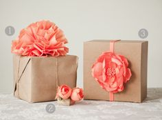 Easy Gift Wrapping using brown paper bags from the grocery store. Give it a color pop with handmade paper flowers as a topper,
