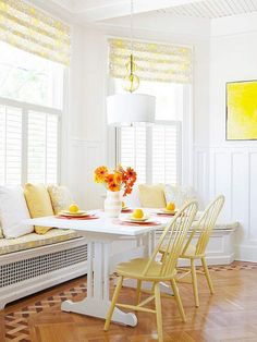 Pops of yellow with white plantation shutters *Yellow printed roman shade above white shutters* So Airy & Beautiful