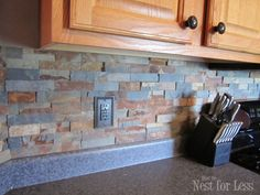 Doing this next week!!! Stone Kitchen Backsplash - like that they painted the plug; don't white ones look horrid standing out as they do against a fabulous backsplash?