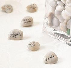 Guest Signing Stones with Vase. These are so cute I'm getting these for my reception tables - Click image to find more Weddings Pinterest pins