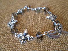 Fleur De Lis Swarovski Bracelet by The Darling by TheDarlingDuck $21- New Orleans, Mardi Gras, Brown, Heart Toggle