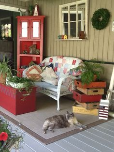 love how the cat is relaxing on the pretty porch! reminds me of the sweet fat cat we had until she left us one hot July us after being sick for a while. Still miss that Splatter cat of mine...