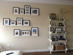 My Pottery Barn photo ledges and studio wall shelf.   Love!!!!!